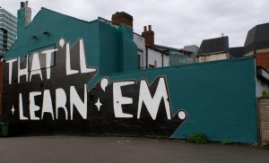 "Image of graffiti stating ""that will learn them"" from Sheila Blige"