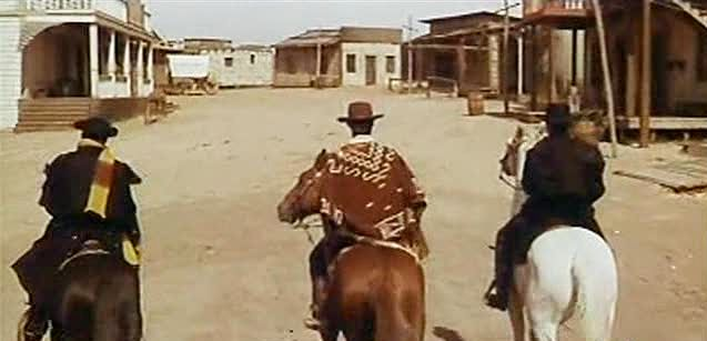 "Three bandits enter a town in a scene from ""Vado... l'ammazzo e torno"" (1967)"