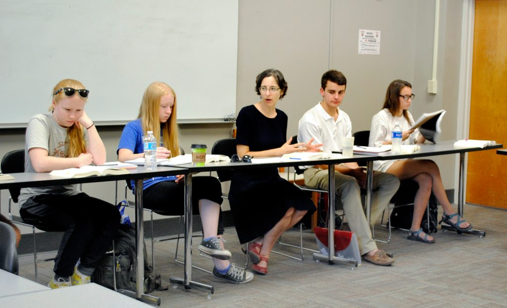 Deborah Weiss talking with students during a class