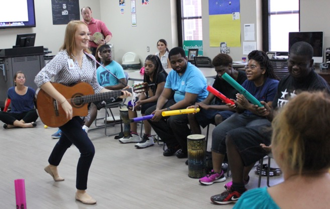 student playing classical guitar as part of a musical therapy program
