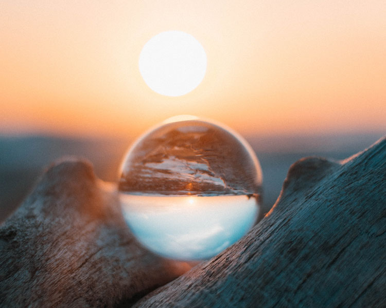 reflection of sunset in glass photography ball
