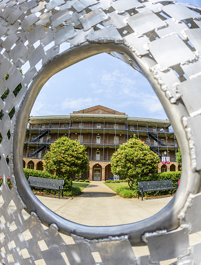 Woods Hall seen through the round, metal sculpture