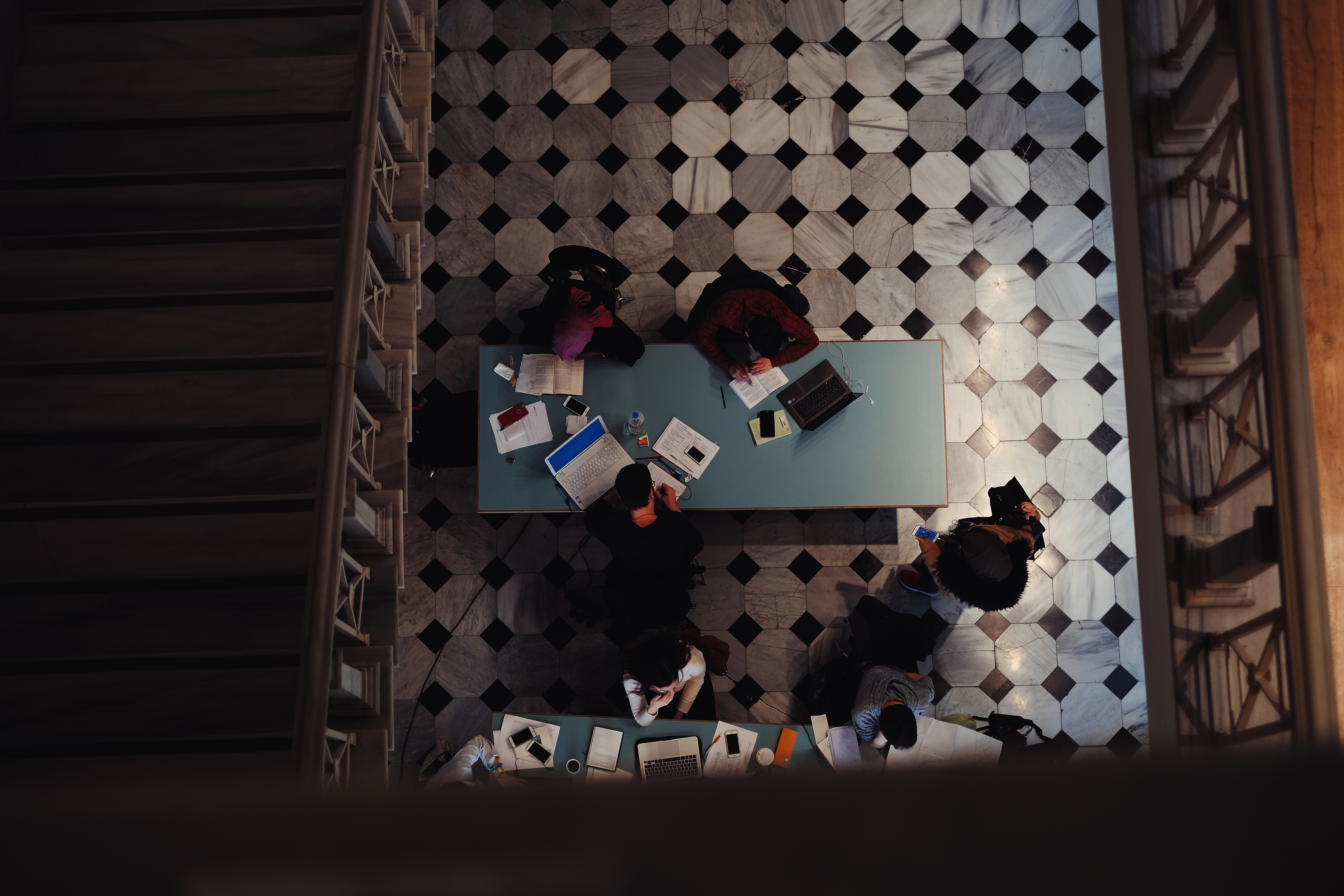 students doing research in a library