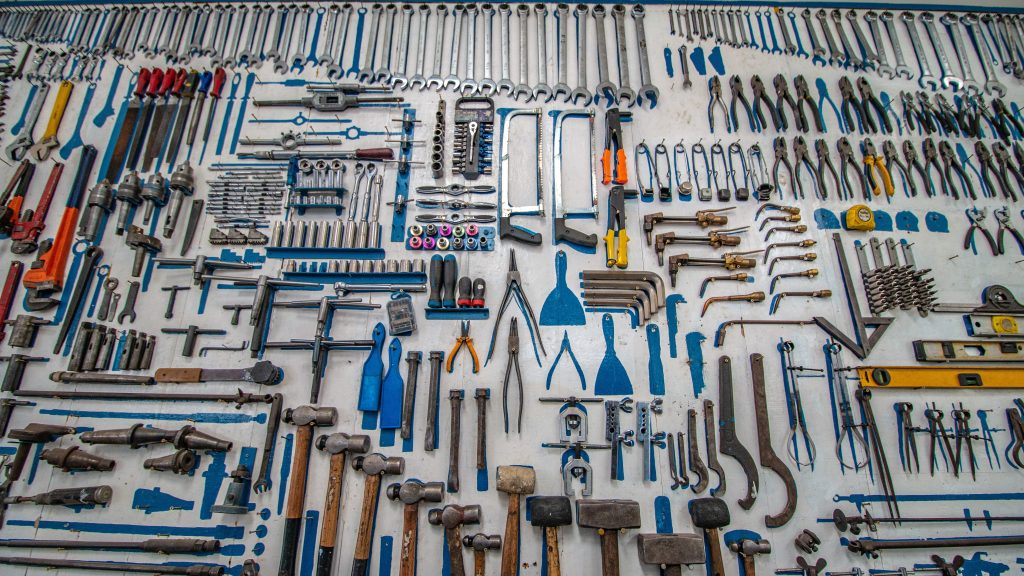table covered with hundreds of simple hand tools