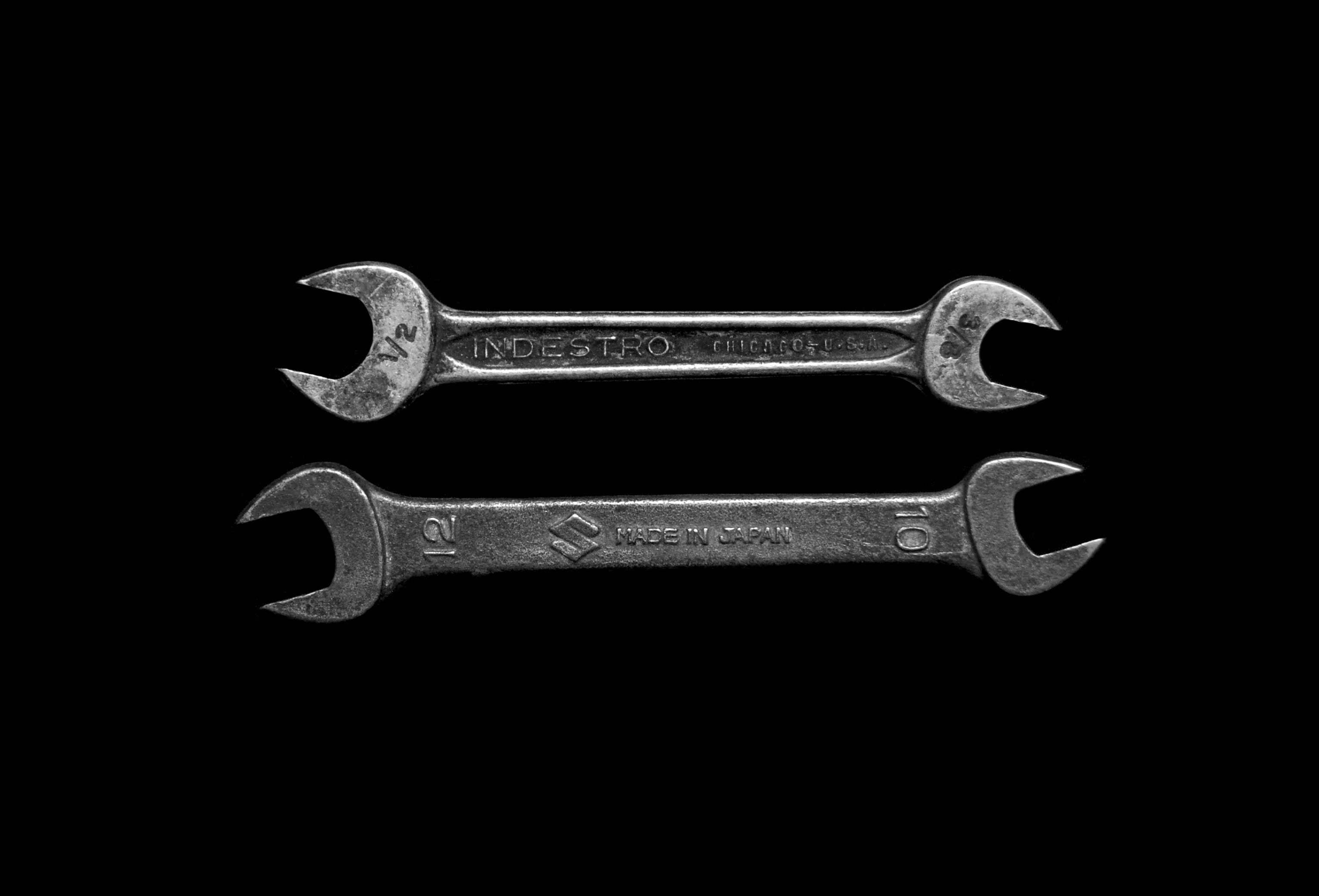 Two wrenches on a table