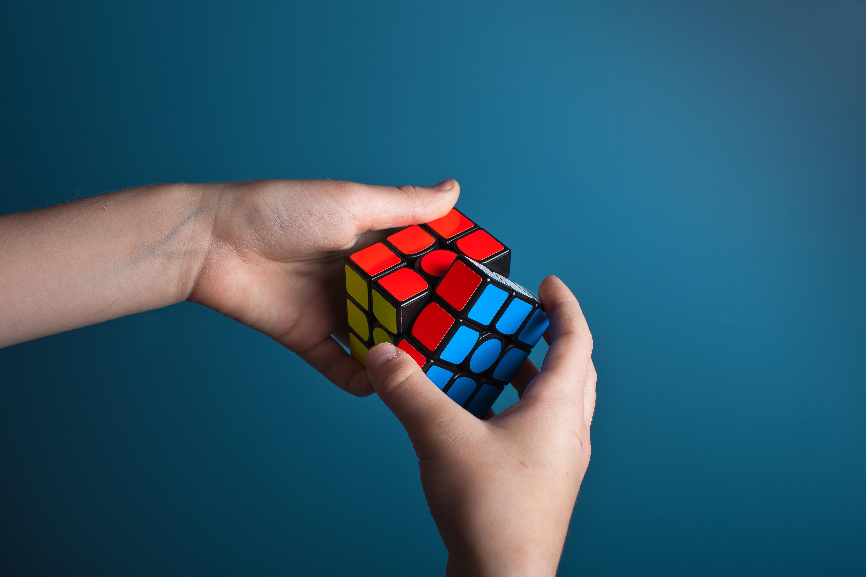 Hands manipulating a magic cube