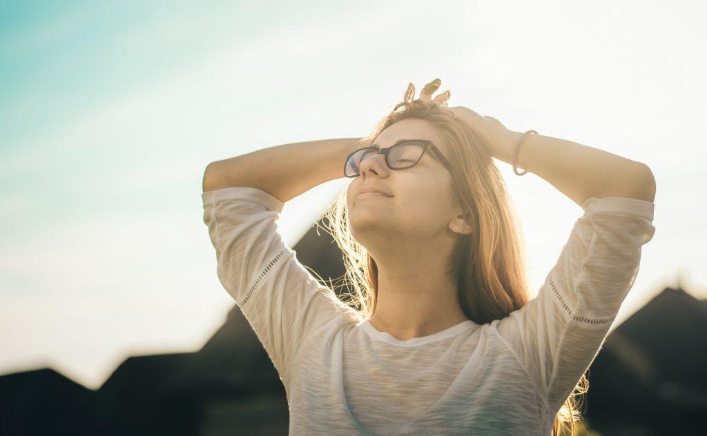 Woman relaxing in sunshine