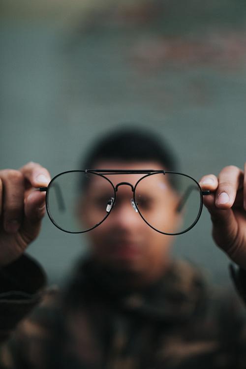 man looking through eyeglasses