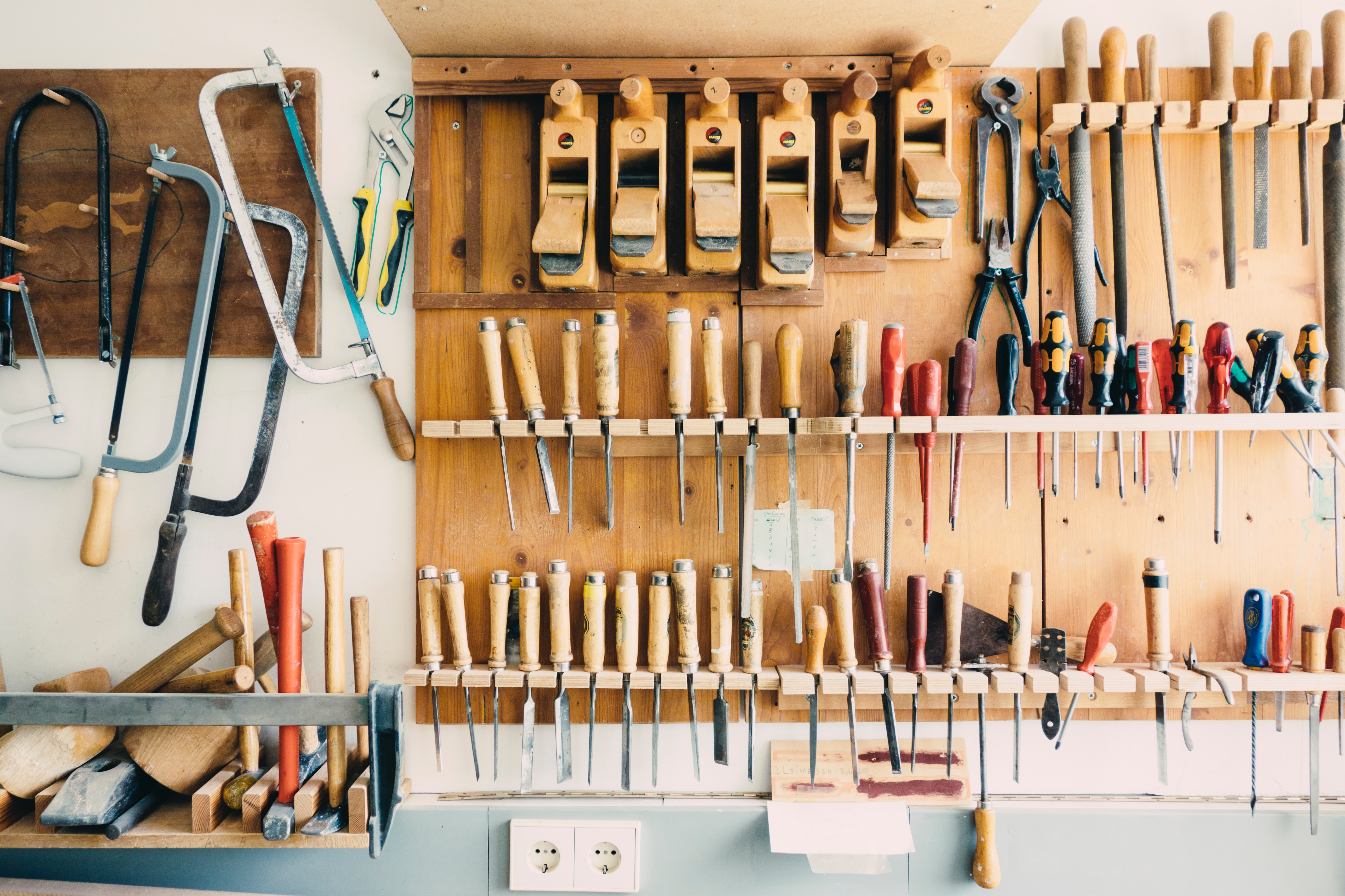 carpenter's workshop with tools hanging on the wall