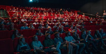 seated people in a large movie theatre