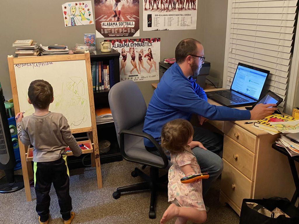 professor's home office teaching amid their children