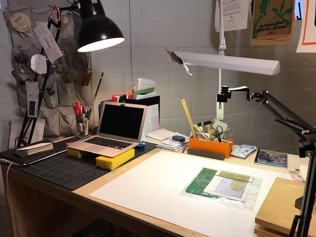 elevated workdesk with tools for book arts