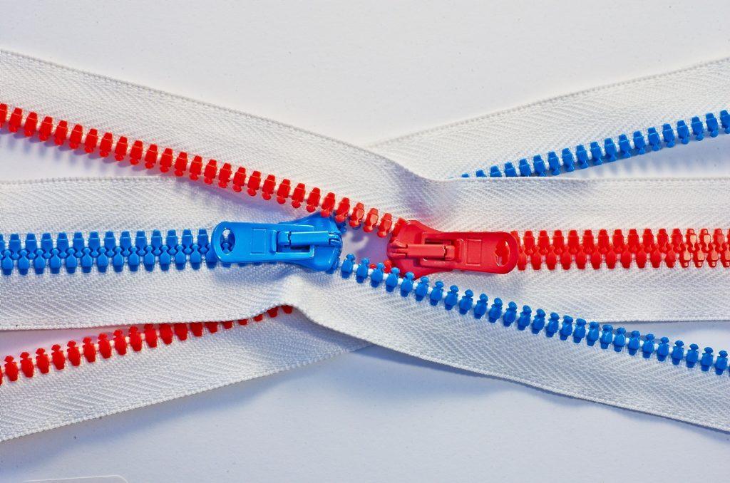 a red and a blue zipper running across each other