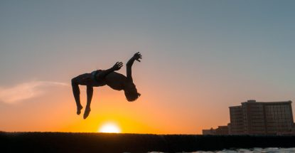 outline of person doing a backflip